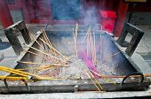 stock photo of lamas  - Burning incenses in Yonghe Temple also known as Palace of Peace and Harmony Lama Temple or simply Lama Temple in Beijing China - JPG