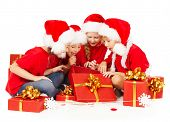 Christmas Kids In Santa Hat Opening Gift Box.  New Year Presents