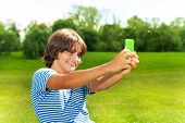 Boy Taking Picture With Cell Phone