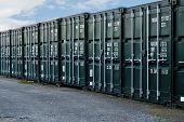 stock photo of smuggling  - line of new freight containers being used a a self storage solution - JPG
