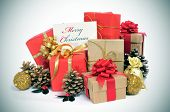 stock photo of christmas greetings  - some christmas gifts wrapped with wrapping paper of different colors and ribbon bows - JPG