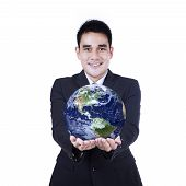 Isolated Businessman Holding A Globe