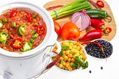 image of ceramic bowl  - Pinto and garbanzo beans cooked in slow cooker with vegetables - JPG