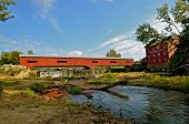 a covered bridge reflect in the water