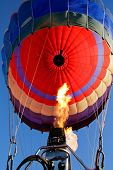 Close-up view of a colorful hot air balloon being inflated with hot air