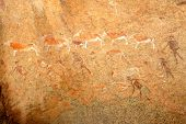 Bushmen rock painting of human figures and antelopes, Brandberg archaeological site, Namibia, southe