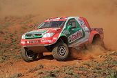 BLOEMFONTEIN, SOUTH AFRICA - OCTOBER 15: Duncan Vos and Rob Howie in their Toyota Hilux in action du