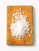 crystal salt on a wooden cutting board