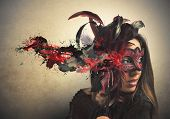 stock photo of female mask  - Beautiful woman with red and black carnival mask - JPG