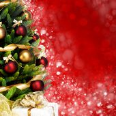 Magically decorated Fir Tree with balls, ribbons and garlands on a blurred Christmas-red shiny, fair