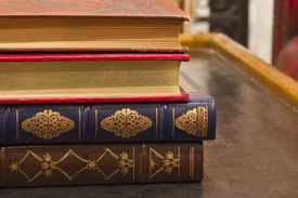 pic of annal  - Antique Books with Gold Inlay Stacked on a Table - JPG