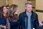 NEW YORK-MAR 13: Singer Jon Bon Jovi (R) and Maria Shriver attend the 'Paycheck To Paycheck: The Lif
