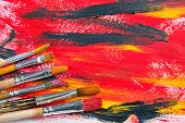 image of bristle brush  - Oil paints and brushes to paint laid on the table in the composition Paints and brushes - JPG