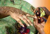 stock photo of henna tattoo  - Applying henna  - JPG