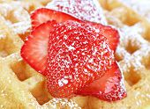 Sliced, Sugared Strawberry On A Waffle.