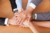 foto of fellowship  - High Angle View Of Businesspeople Stacking Hands Over Each Other - JPG