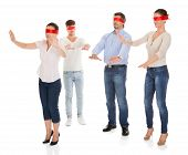 image of blindfolded man  - Group Of A People With Red Ribbon Tied On Eyes Isolated Over White Background - JPG