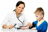 Little boy at paediatrician office measuring blood pressure