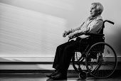 stock photo of wheelchair  - Thoughtful senior man in wheelchair in nursing home - JPG