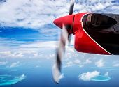 Summer traveling concept, small plane flying to the beach resort, scene destination, luxury aerial t