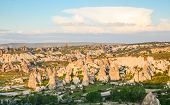 stock photo of chimney rock  - Chimney rock formations illuminated by setting sun Cappadocia Turkey - JPG