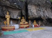 Three Different Statues Of Buddha