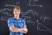 Portrait of a student at the blackboard background with patterns