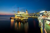 foto of derrick  - Gas platform or rig platform in sunset or sunrise time - JPG
