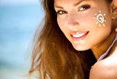 stock photo of sunbathing  - Suntan Lotion Woman Applying Sunscreen Solar Cream - JPG