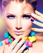 Fashion Beauty model girl with colorful Nails. Vivid rainbow manicure and accessories. Beautiful wom