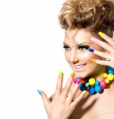 Beauty Girl Portrait with Colorful Makeup, Nail polish and Accessories. Studio Shot of Funny Woman. Vivid Colors. Colourful Manicure and fashion Hairstyle. Rainbow Colors. Beautiful lady. Make up