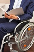 Businessman Working In A Wheelchair