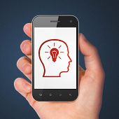 Marketing concept: Head With Lightbulb on smartphone