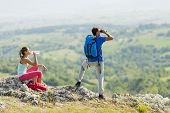 Young Couple Hiking On The Mountain