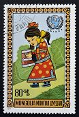 MONGOLIA - CIRCA 1977: stamp printed in Mongolia shows Girl carrying bucket circa 1977
