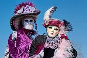 Two female portraits at the carnival in Annecy, France