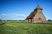 Ancient Medieval Church Landscape Against Evening Summer Sky