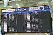 Vancouver, BC Canada - September 13, 2014 : Macro airport departures monitor showing flight gate in ancouver BC Canada.
