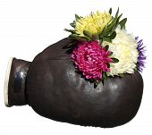 Boxing Glove With A Bouquet Of Flowers Isolated On White Background.