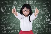 Little Student Girl With Thumbs Up