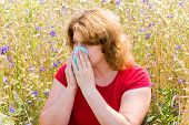 Fat Woman With Allergic Rhinitis In  Meadow