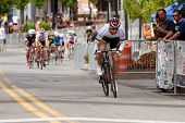 Cyclist Separates Himself From Pack In Criterium Event
