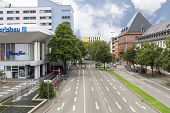 FREIBURG IM BREISGAU, GERMANY - AUGUST 6, 2014: Modern town street in Freiburg, a city in the south-western part of Germany in the Baden-Wurttemberg state.