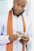 African American man holding money