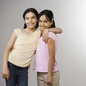 Hispanic sisters hugging