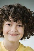 Hispanic boy with curly hair