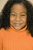 Pacific Islander girl with curly hair