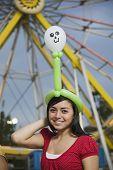 Mixed race teenaged girl at carnival