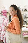 Hispanic woman at clothing store