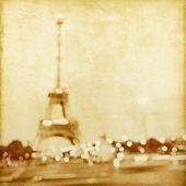 Defocused lights of night Paris in grunge and retro style.
